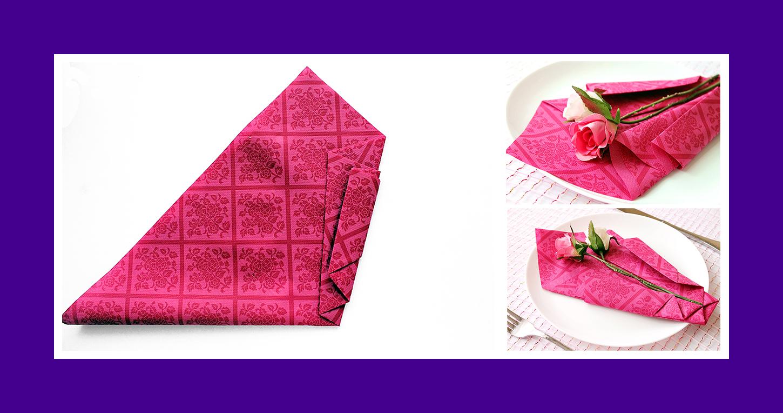 Rote Papierserviette zum Frauentag falten